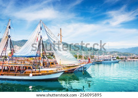 Tourist boats in port of Alanya, Turkey. Beautiful view on the sea and mountains - stock photo