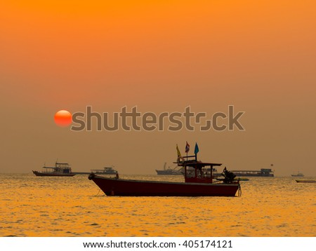 Tourist boats on the pattaya beach at sunset,made with Vintage Tones,Warm tones , with Effects filters - stock photo