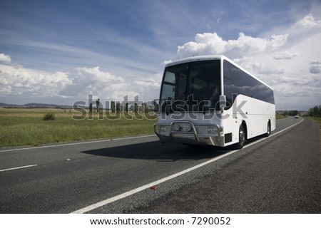 tourist bus traveling down a major highway - stock photo