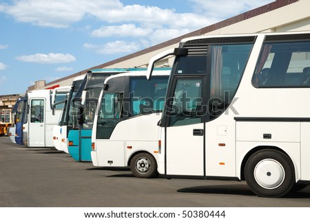 Tourist buses on a parking expect passengers - stock photo