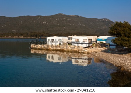 Tourist camp area for caravans near sea in small village Hodilje near Ston on Peljesac peninsula, Croatia, Europe. - stock photo