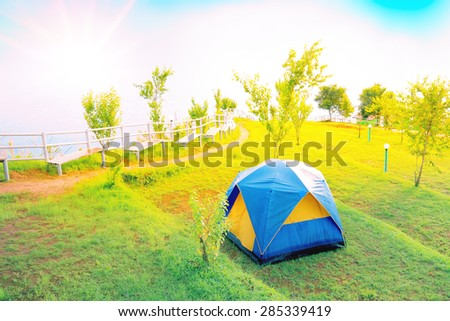 Tourist camping tent on top of mountain in Thailand with morning light shade - stock photo