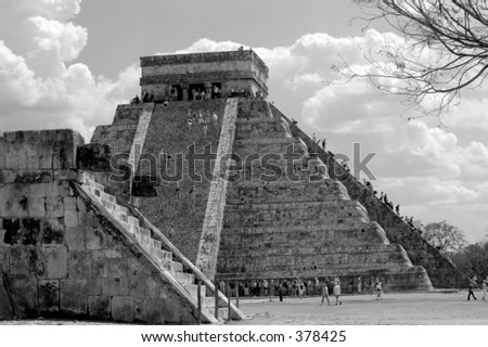 Tourist climbing main pyramid in Chichen Itza, Mexico