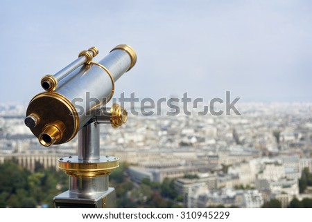 Tourist coin operated telescope looking out over a city view - stock photo