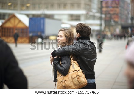 Tourist couple on vacation is walking around the city - stock photo
