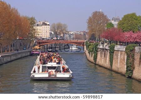 Tourist cruise boat in River Seine Paris France - stock photo