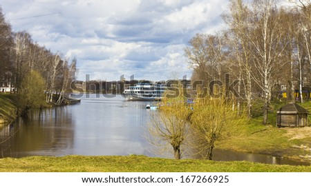 Tourist cruise ship on river Volga arrives in port of historical town Uglich, Russia. - stock photo