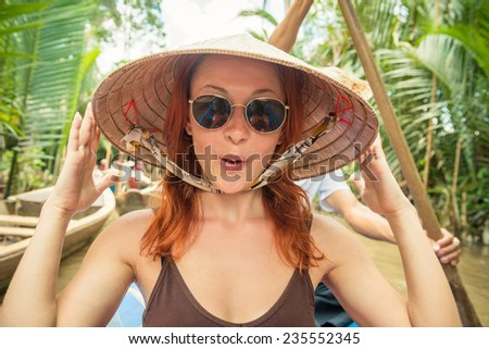Tourist enjoying Mekong delta cruise with daily trips to local sights - stock photo