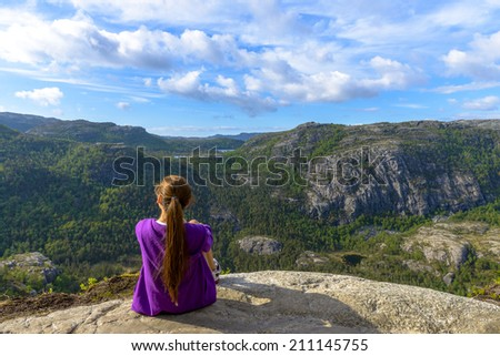 Tourist enjoying Norway's beautiful scenery near Pulpit Rock - stock photo