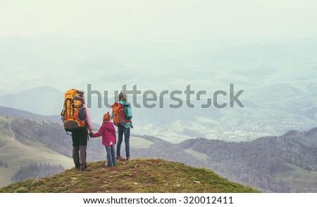 tourist girls and mountain views - stock photo