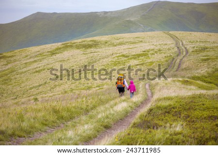 tourist girls mother and daughter and mountain views  - stock photo