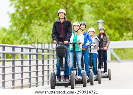 Tourist group having guided Segway city tour in Germany - stock photo