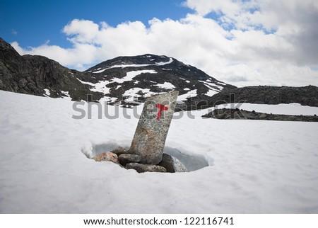 tourist icon in snow - stock photo