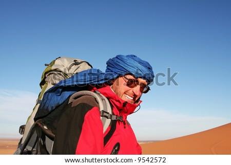Tourist in desert - stock photo