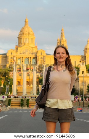 Tourist in front of a building - stock photo