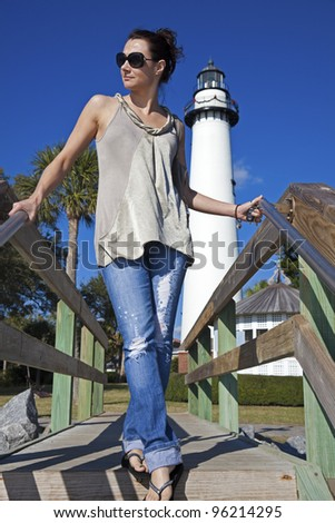 Tourist in front of Saint Simons Lighthouse - Brunswick area, Georgia - stock photo
