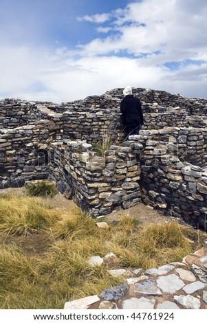 Tourist in Gran Quivira Ruins, New Mexico. - stock photo