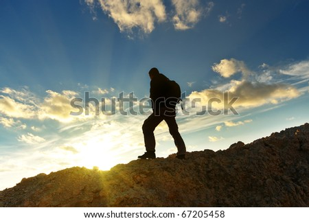 Tourist in mountain. Element of design. - stock photo