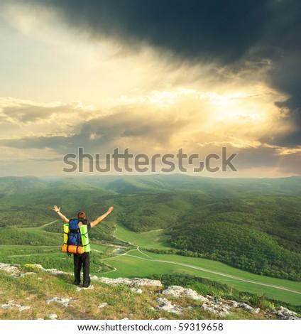 Tourist in mountain. Emotional scene. Element of design. - stock photo