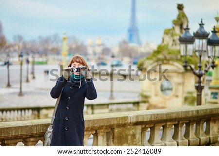 Tourist in Paris taking a picture - stock photo