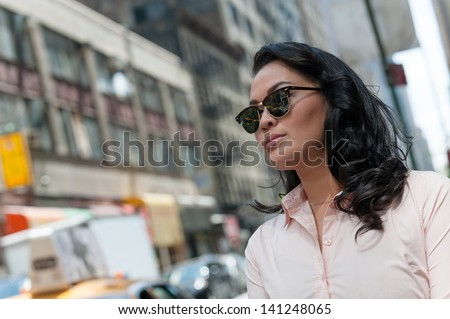 Tourist in sunglasses in Manhattan, NYC  - stock photo