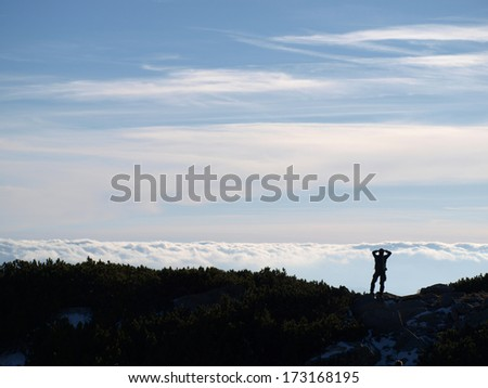 Tourist in the Slovak Tatras - above the clouds - stock photo