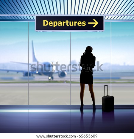 tourist info signage in airport and silhouette of passenger - stock photo