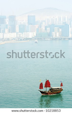 Tourist Junk in Victoria Harbor, Hong Kong - stock photo