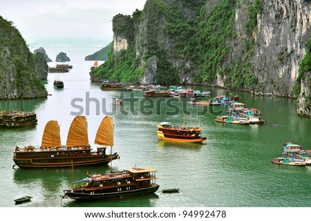 Tourist Junks and Floating village in Halong Bay, Vietnam. - stock photo
