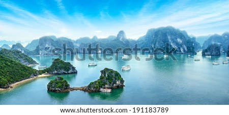 Tourist junks floating among limestone rocks at early morning in Ha Long Bay, South China Sea, Vietnam, Southeast Asia. Five images panorama - stock photo
