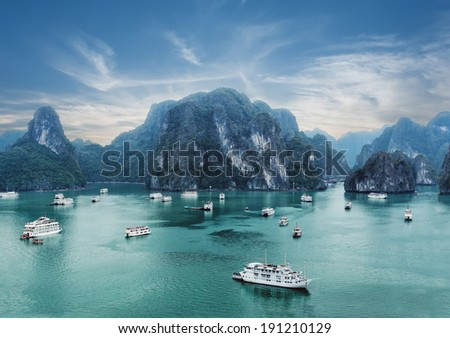 Tourist junks floating among limestone rocks at early morning in Ha Long Bay, South China Sea, Vietnam, Southeast Asia. Two images panorama - stock photo