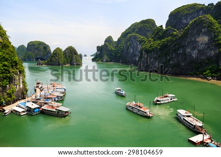 Tourist junks floating among limestone rocks at Halong Bay. Halong Bay is the World's Natural heritage. - stock photo