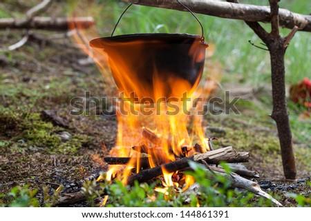 Tourist kettle on fire - stock photo