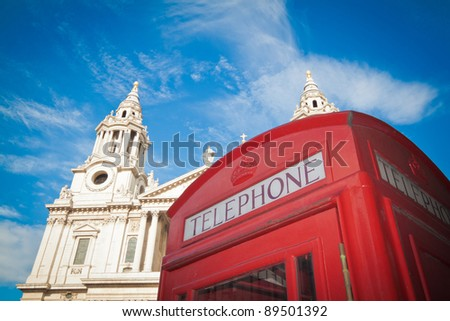 Tourist London: red phone box against the facade of St Paul's cathedral. - stock photo