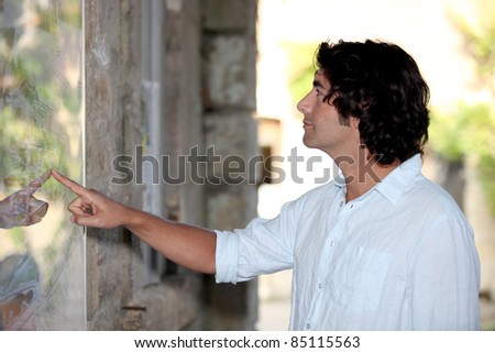 Tourist looking at a map - stock photo
