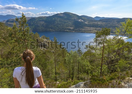 Tourist looking at beautiful Norway scenery near Pulpit Rock - stock photo