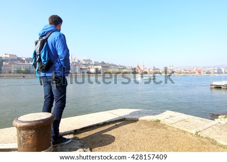 Tourist looking at the Danube river in Budapest, Hungary. - stock photo
