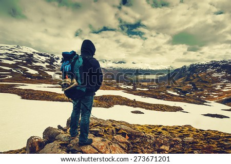 tourist  man top of mountain with backpack