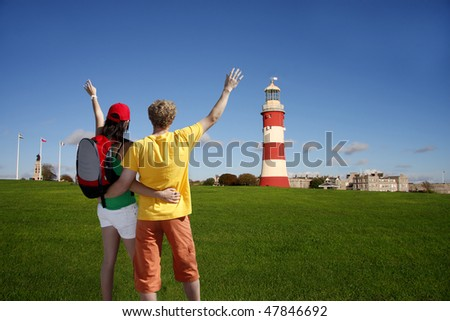 tourist near the lighthouse in Plymouth, Devon, UK - stock photo