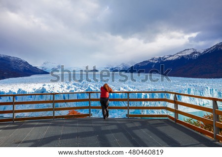 Tourist near the Perito Moreno Glacier, Argentina. Perito Moreno is a glacier located in the Los Glaciares National Park in the Argentinian Patagonia.