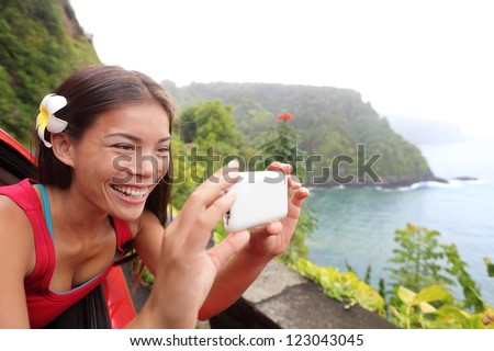 Tourist on Hawaii taking photo with camera phone during car road trip on the famous Road to - stock photo