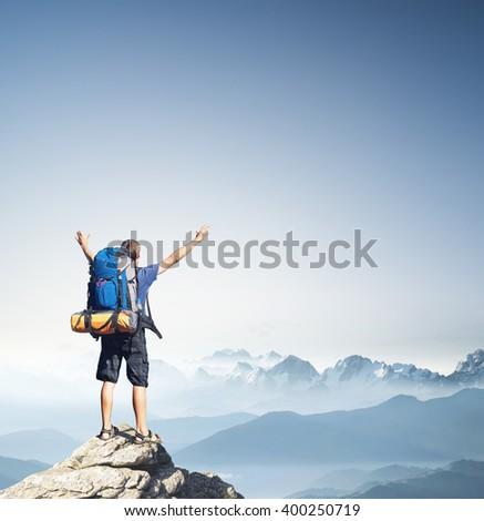 Tourist on mountain peak. Sport and active life concept - stock photo