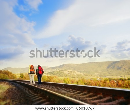 tourist on railway - stock photo