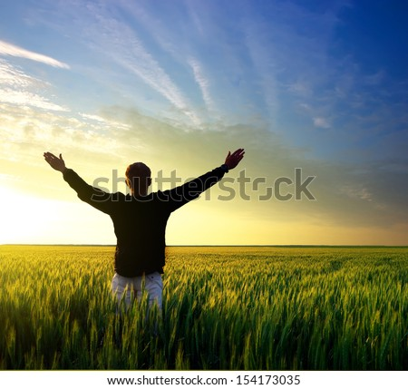 Tourist on the field during sundown. Sport and healthy life concept - stock photo