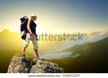 Tourist on the rock. Sport and active life concept - stock photo