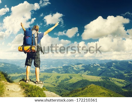 Tourist on the sky background. Sport and active life concept - stock photo