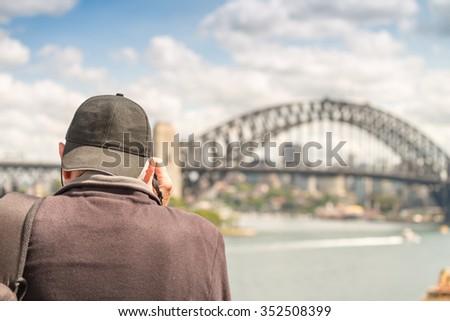 Tourist photographing Sydney skyline, New South Wales, Australia. - stock photo