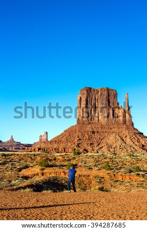 Tourist photographs Monument Valley in late afternoon - stock photo