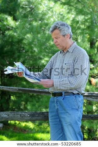 Tourist reading a map - stock photo