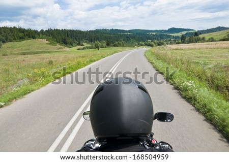 Tourist riding a motorcycle - stock photo